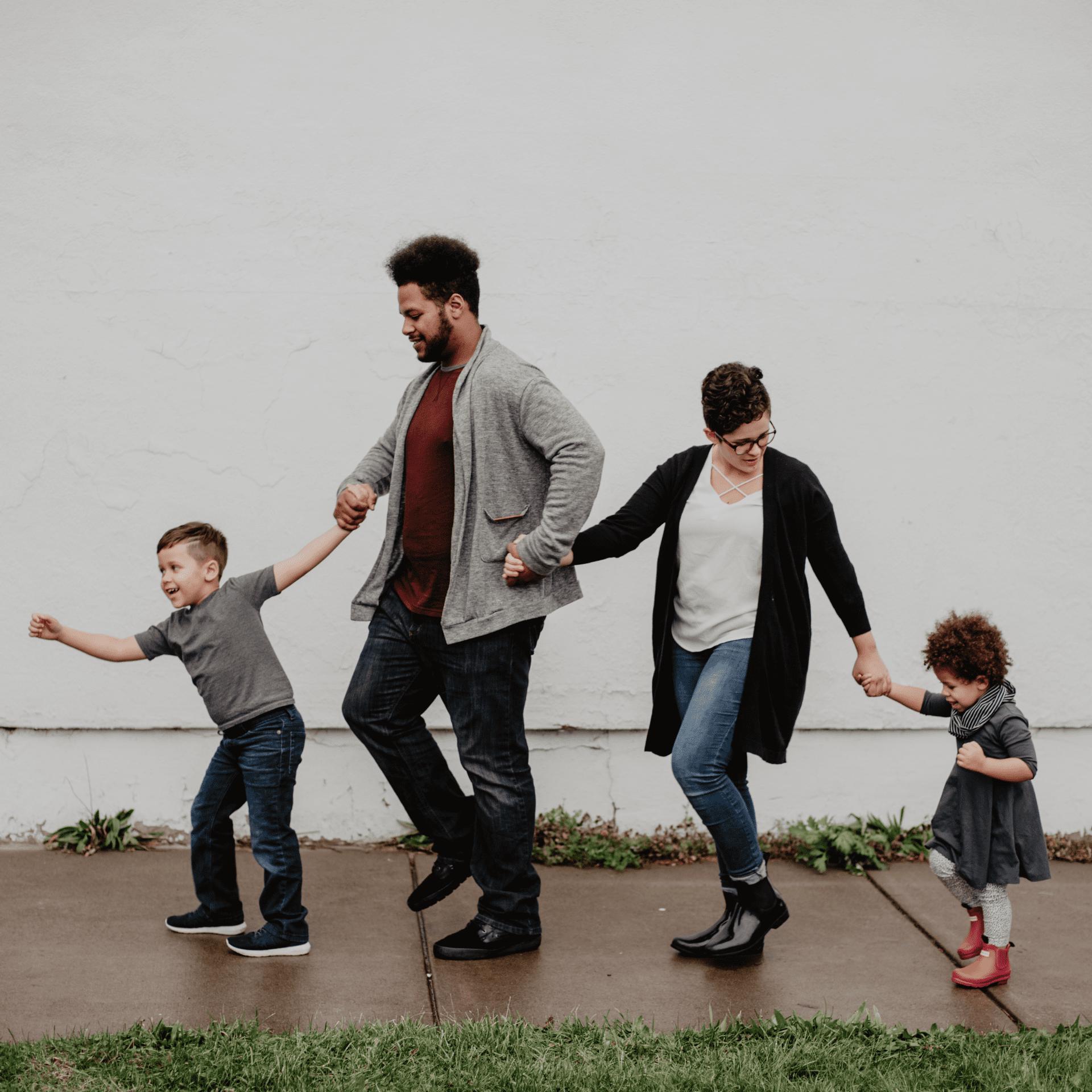 Family walking down the sidewalk